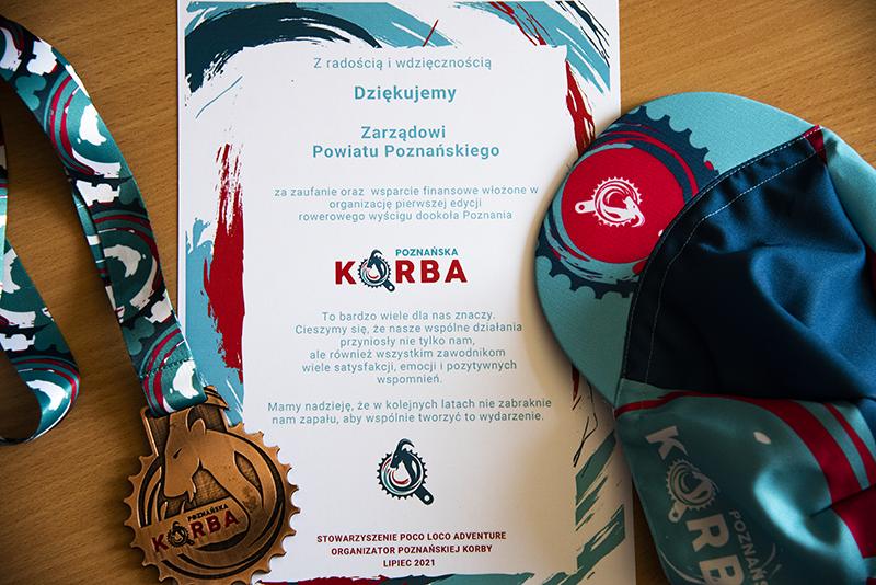 podziękowanie dla Zarządu Powiatu w Poznaniu za wsparcie organizacji pierwszej edycji rowerowego wyścigu dookoła Poznania Poznańska Korba